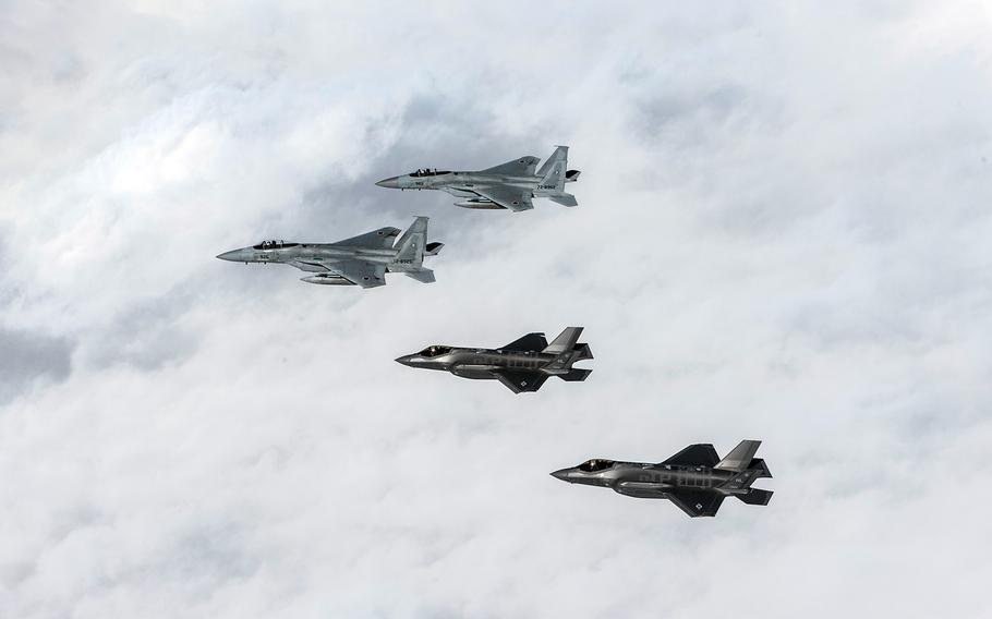 U.S. Air Force F-35A Lightning IIs and Japan Air Self-Defense Force F-15 Eagles train over the Pacific Ocean, Dec. 4, 2017.
