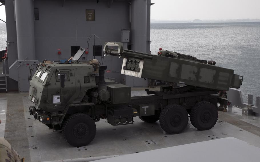A Marine Corps M142 High Mobility Artillery Rocket System, or HIMARS, launcher raises and swivels on the deck of an Army vessel at Kin, Okinawa, Thursday, Oct. 31, 2019.