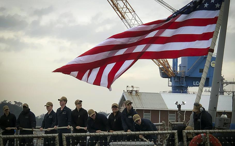 Sailors aboard the USS John S. McCain return to Yokosuka Naval Base, Japan, Sunday, Nov. 3, 2019, after the ship's first sea trials since a deadly collision in August 2017.