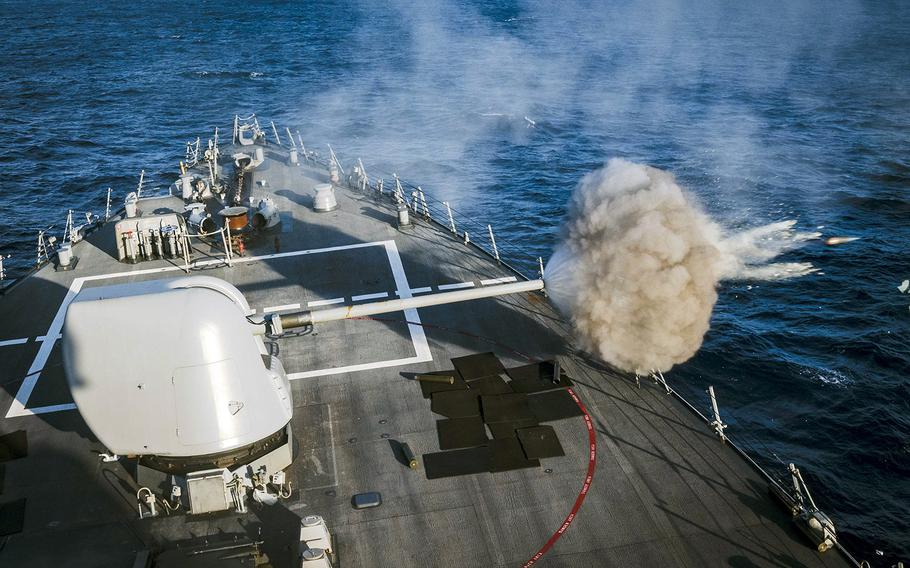 The guided-missile destroyer USS John S. McCain fires its 5-inch gun during a live-fire exercise in the Philippine Sea, Wednesday, Oct. 30, 2019.