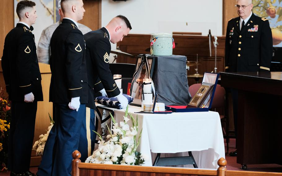 Soldiers from the 142nd Military Police Company place a folded flag before a photo of deceased Army veteran Kurt Dressler inside South Post Chapel at Yongsan Garrison, South Korea, Friday, Nov. 1, 2019. Dressler, a former German submariner during World War II, died of pneumonia at age 91.