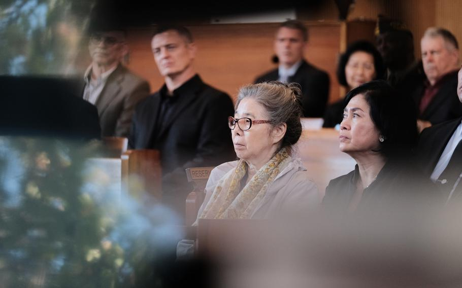 Wol Yo Dressler, center, attends a memorial ceremony for her late husband, Army veteran Kurt Dressler, 91, inside South Post Chapel at Yongsan Garrison, South Korea, Friday, Nov. 1, 2019.