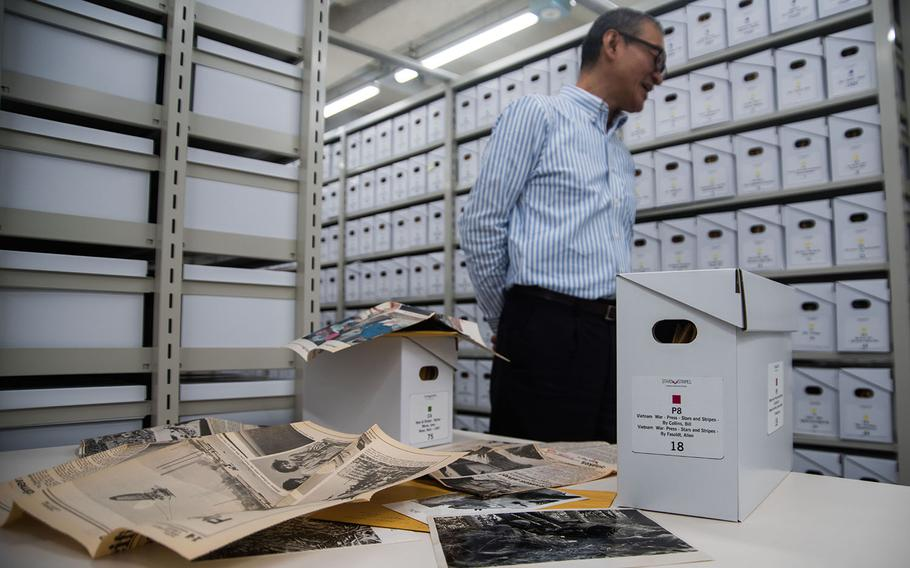Boxes filled with photographs, newspaper clippings and other materials line the walls of Stars and Stripes Pacific's library at Hardy Barracks in Tokyo, Thursday, Oct. 31, 2019.