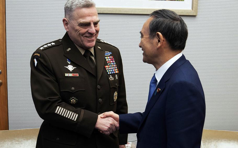 Gen. Mark Milley, chairman of the Joint Chiefs of Staff, meets with Japanese Chief Cabinet Secretary Yoshihide Suga at the Kantei in Tokyo, Wednesday, Nov. 13, 2019.