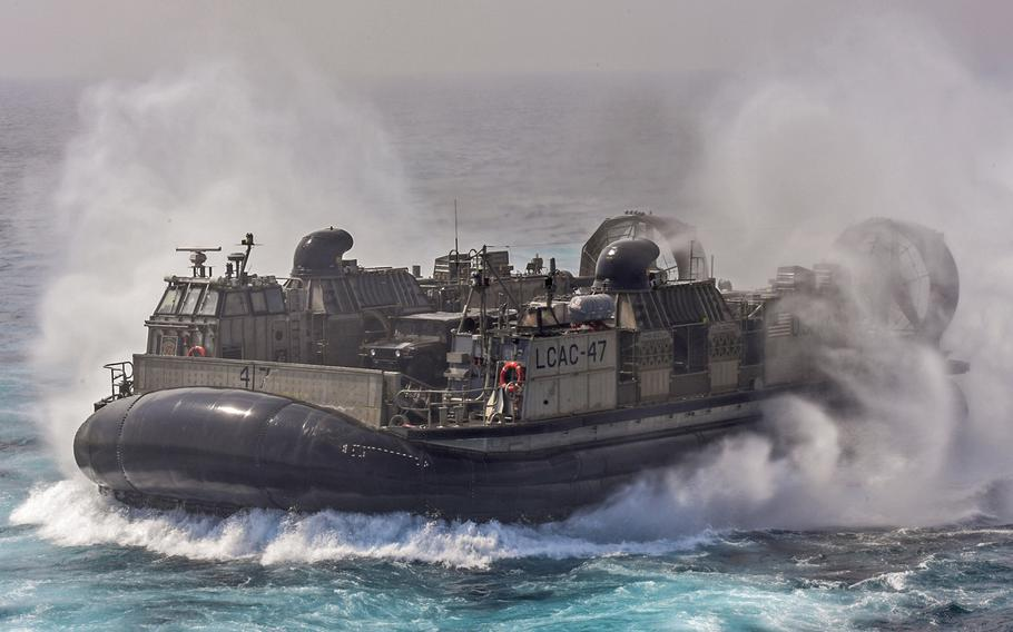 A landing craft assigned to Naval Beach Unit 7 transits from the dock landing ship USS Germantown during exercise Tiger Triumph, in the Bay of Bengal, India, on Nov. 17, 2019.