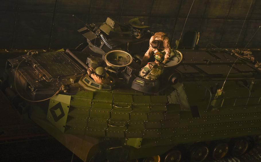 U.S. Marines from 2nd Battalion, 2nd Marine Regiment, and Indian Army forces prepare to drive a U.S. assault amphibious vehicle from the well deck of the dock landing ship USS Germantown during exercise Tiger Triumph in the Bay of Bengal, India, Nov. 19, 2019.