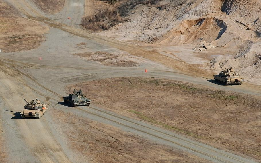 M1 Abrams tanks from the Army's 3rd Armored Brigade Combat Team and a T-80U tank from South Korea's 3rd Armored Brigade conduct a live-fire battle exercise at Rodriguez Live Fire Range in Pocheon, South Korea, Tuesday, Nov. 19, 2019.