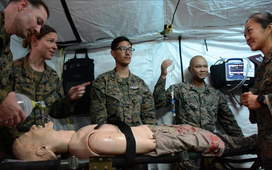 Navy doctors and hospital corpsmen assigned to the 3rd Medical Battalion work on a simulated casualty inside a Role 2 field hospital at Camp Hansen, Okinawa, Thursday, Nov. 21, 2019.