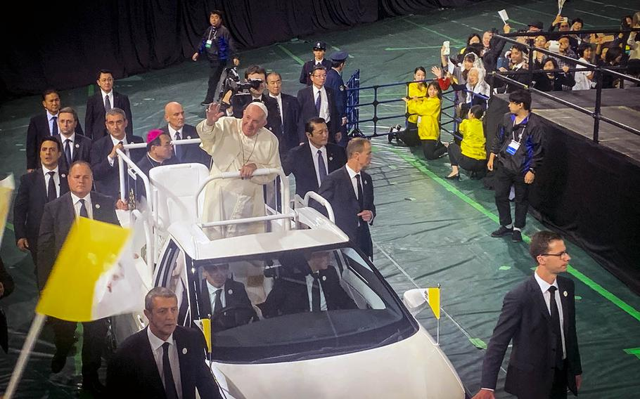 Pope Francis  greets a crowd of 55,000 at the Tokyo Dome, Japan, gathered for Mass on Monday, Nov. 25, 2019.