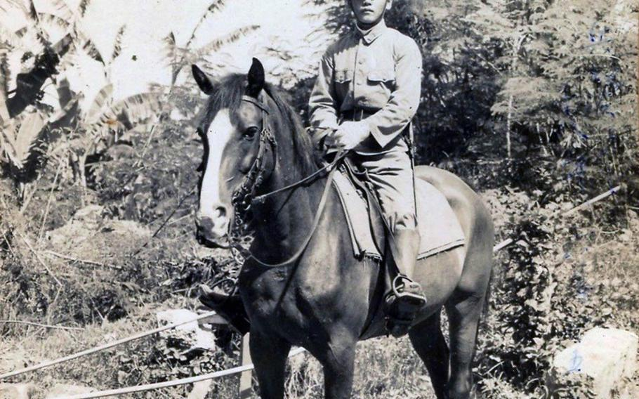 A photograph of Hideo Shikata on horseback, taken sometime during World War II, was returned with about 20 others to his family in Japan on Sunday, Nov. 24, 2019.