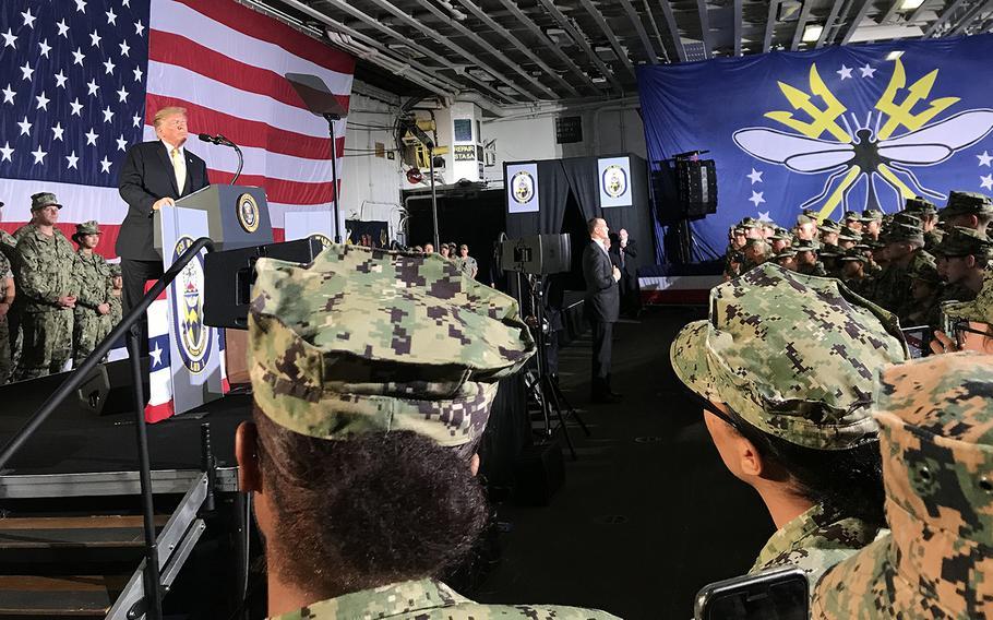 Japan-based sailors and Marines listen to President Donald Trump speak aboard the USS Wasp in Yokosuka, Japan, May 28, 2019.