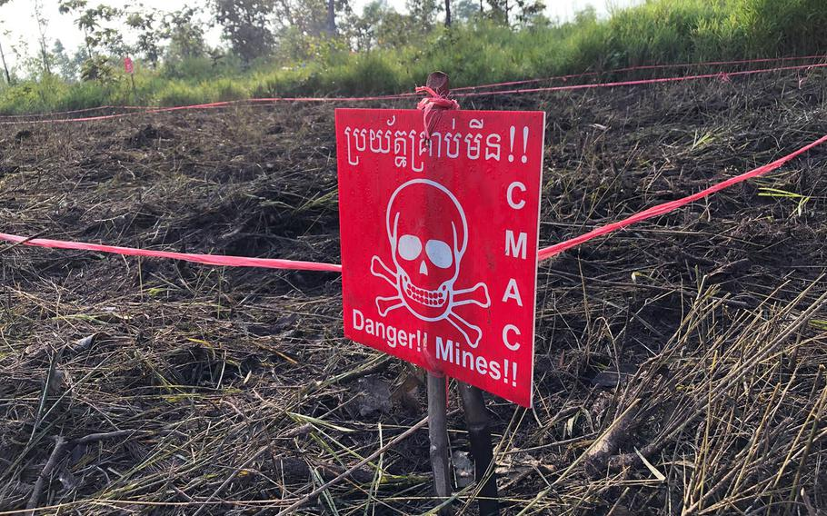 A warning sign marks the edge of a suspected minefield in the countryside north of Siem Reap, Cambodia, on Nov. 6, 2019.