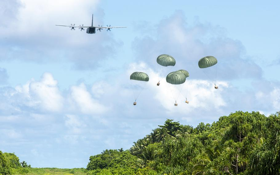 An Air Force C-130J Super Hercules out of Yokota Air Base, Japan, delivers bundles filled with critical supplies to the island of Woleai, Micronesia, during Operation Christmas Drop, Tuesday, Dec. 10, 2019.