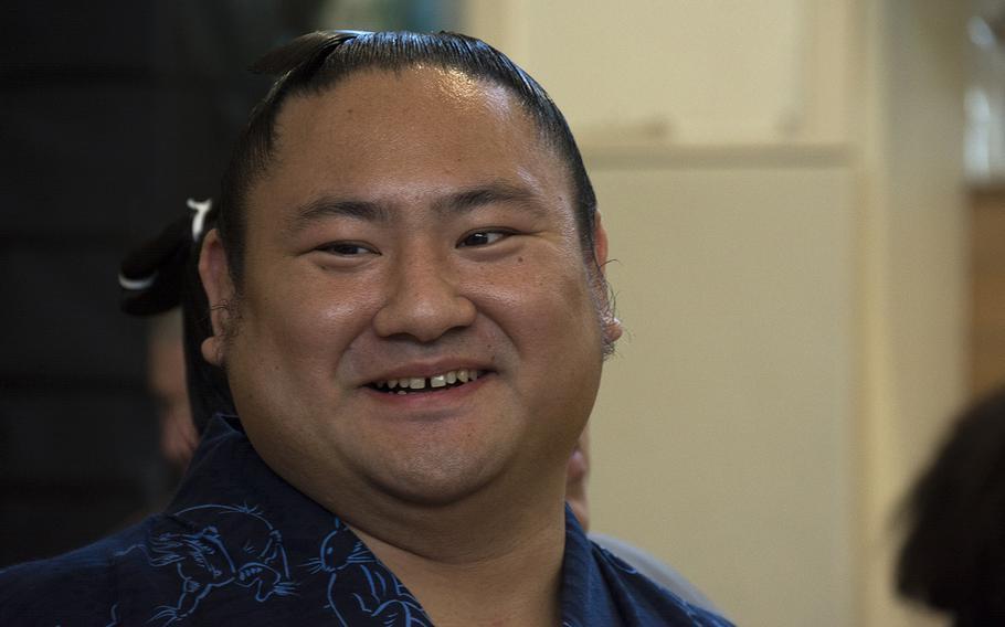 Japanese sumo wrestler Kotoeko speaks with staff at Lester Middle School on Camp Lester, Okinawa, Friday, Dec. 13, 2019.