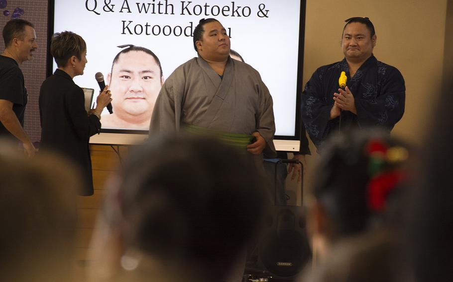 Japanese sumo wrestlers Kotoeko, far right, and Kotooodutsu answer questions from students at Lester Middle School on Camp Lester, Okinawa, Friday, Dec. 13, 2019.