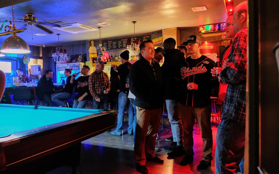Airmen from the 51st Fighter Wing relax at a bar just outside Osan Air Base, South Korea, on Saturday, Dec. 14, 2019.