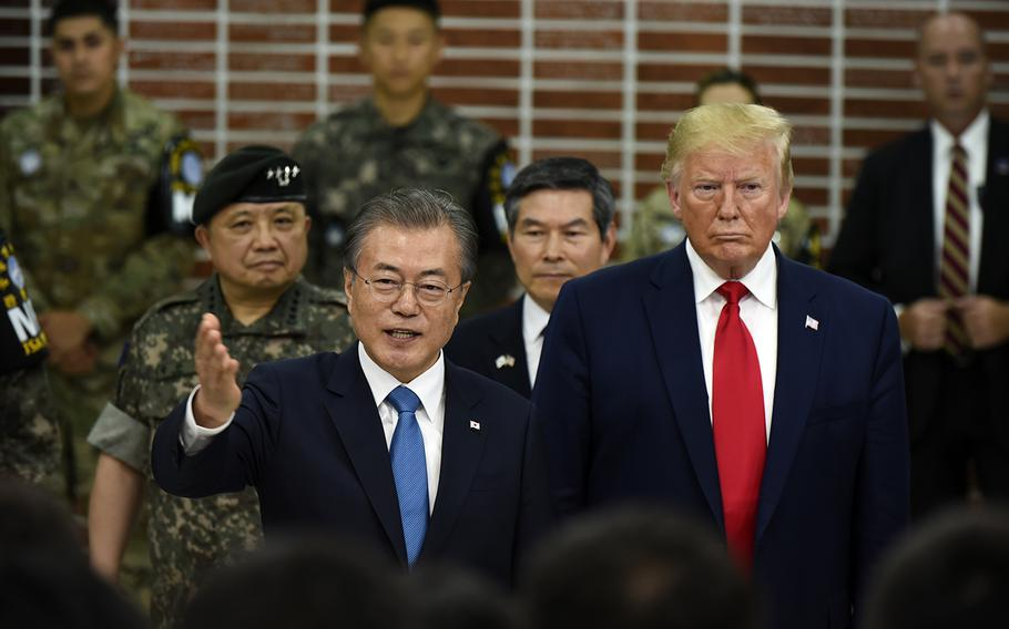 President Donald Trump and South Korean President Moon Jae-in speak with soldiers stationed at the Joint Security Area between the two Koreas, June 30, 2019.