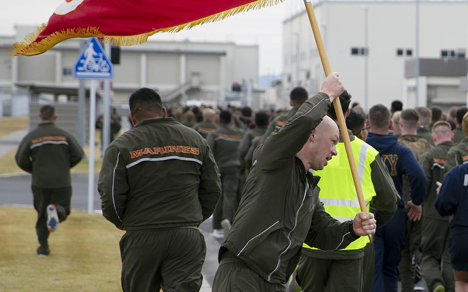 Marines with Marine Aerial Refueler Transport Squadron 152 participate in a memorial run at Marine Corps Air Station Iwakuni, Japan, Dec. 5, 2019. The event honored  five Marine aviators killed last year in a midair collision off Japan.