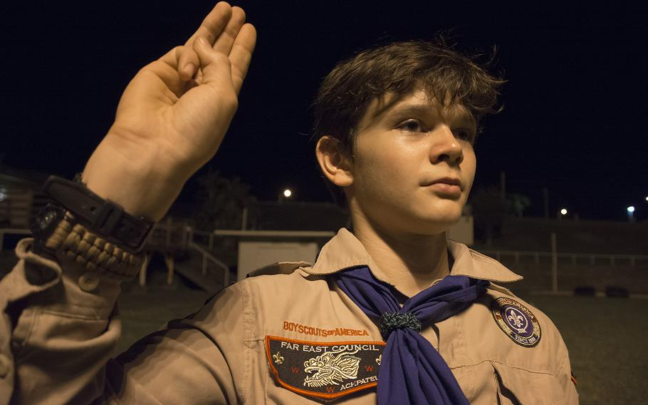 Ian Clingan, a Life Scout with the Scouts BSA Troop 110, does the Scout Sign during a meeting at Camp Courtney, Okinawa, Wednesday, Dec. 18, 2019.