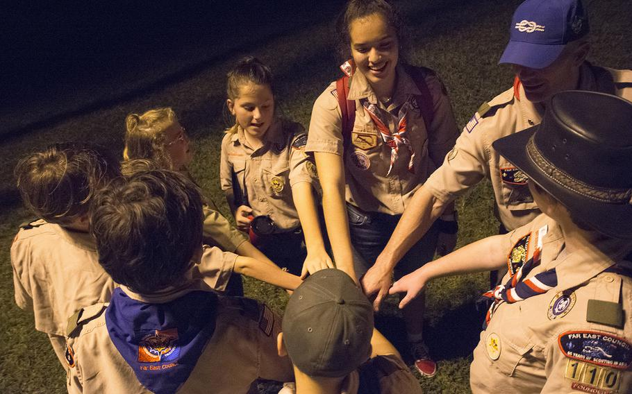 Members of the Scouts BSA Troop 110 huddle after a meeting at Camp Courtney, Okinawa, Wednesday, Dec. 18, 2019.
