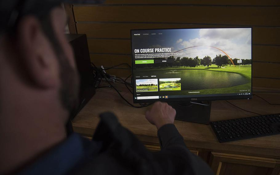 Patrick Bowman, the golf pro at the Yokota Air Base Par 3 Golf Course, Tokyo, Japan, explains how the new Trackman simulator can improve a player's game on Dec. 13, 2019.