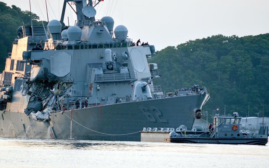 The guided-missile destroyer USS Fitzgerald returns to Yokosuka Naval Base, Japan, following a collision with a merchant vessel that killed seven sailors, June 17, 2017.
