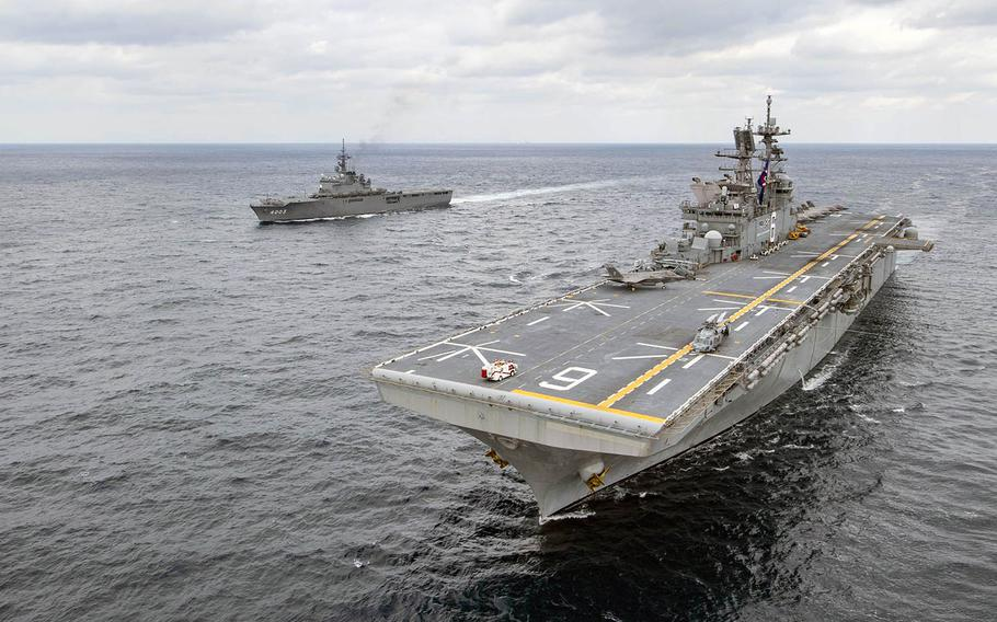 The amphibious assault ship USS America and the Japan Maritime Self-Defense Force amphibious transport dock ship JS Kunisaki steamed together in the East China Sea on Jan. 13, 2020.