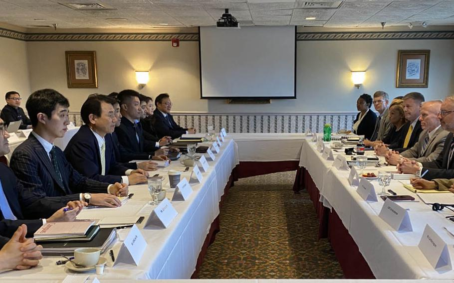 South Korean negotiators, left, meet with their U.S. counterparts for a sixth round of defense cost-sharing talks Tuesday, Jan. 14, 2020, in Washington, D.C.
