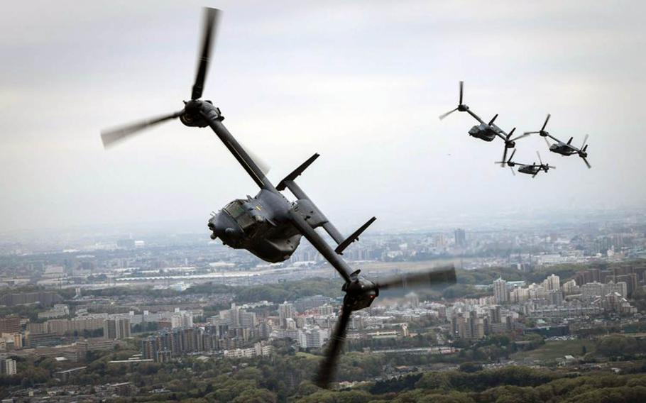 Air Force CV-22 Ospreys assigned to the 353rd Special Operations Group fly over Tokyo, April 5, 2018.