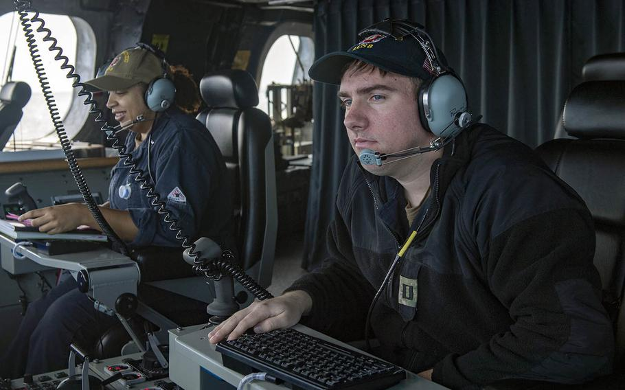 Lt. Trevor Kent stands watch on the USS Montgomery during routine operations near Johnson Reef in the South China Sea on Saturday, Jan. 25, 2020.