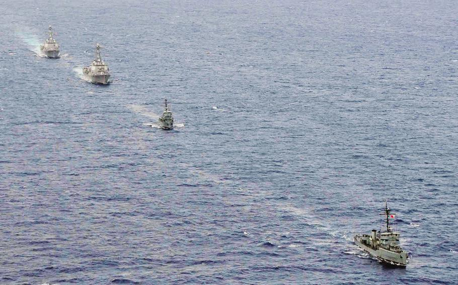 The BRP Rizal and BRP Pangasinan of the Philippine Navy train with the guided-missile destroyers USS Howard and USS Chung-Hoon during Cooperation Afloat Readiness and Training in the Philippines in 2011.