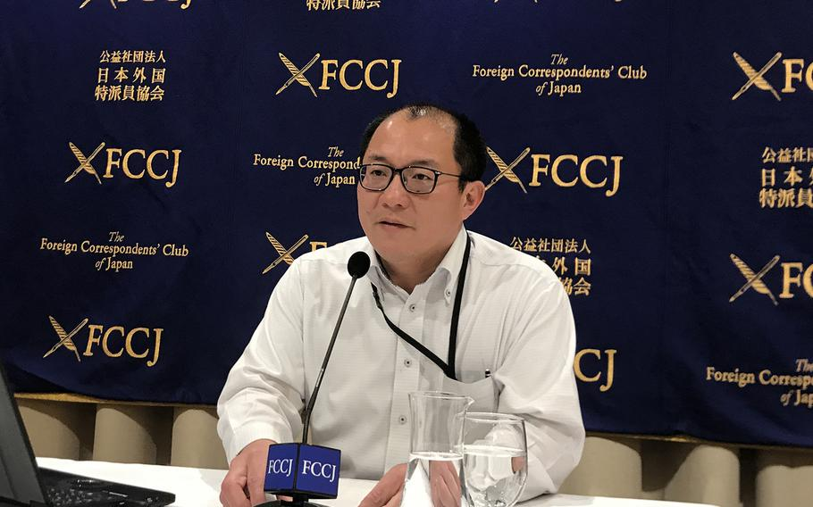Hokkaido University professor Hiroshi Nishiura, who leads a team of researchers studying the path of the novel coronavirus, speaks at the Foreign Correspondents' Club of Japan in Tokyo, Tuesday, Feb. 4, 2020.