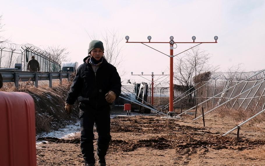 A South Korean employee of U.S. Forces Korea works at Osan Air Base, South Korea, Thursday, Feb. 6, 2020.