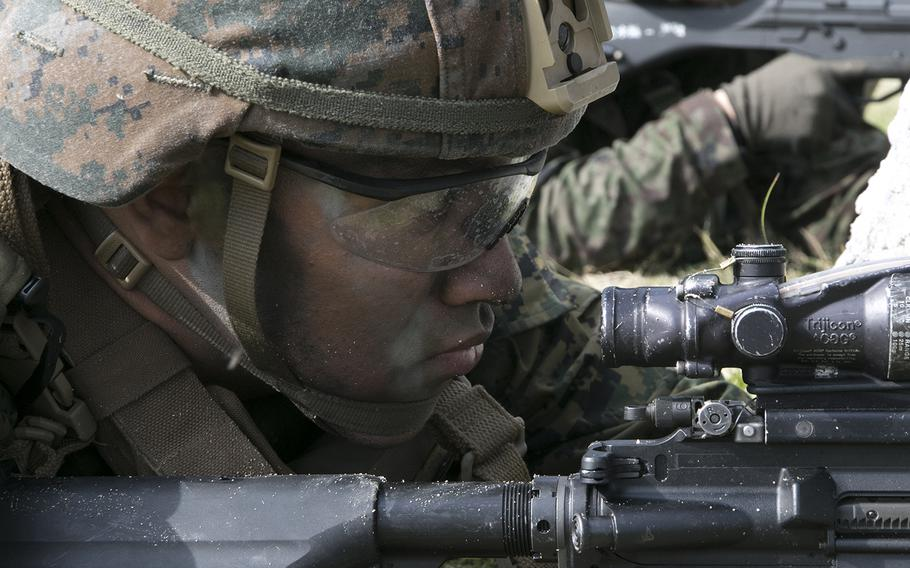 A member of the 31st Marine Expeditionary Unit serves as security following an exercise in Kin, Okinawa, Sunday, Feb. 9, 2020.