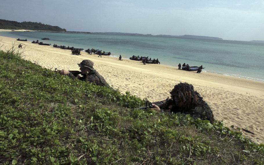 U.S. Marines come ashore with members of the Japan Ground Self-Defense Force's new amphibious brigade during an exercise in Kin, Okinawa, Sunday, Feb. 9, 2020.