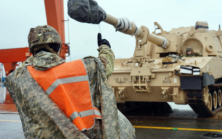 Tanks and other equipment are off-loaded at a port in South Korea ahead of the arrival of the Fort Riley, Kansas-based 2nd Armored Brigade Combat Team, 1st Infantry Division.