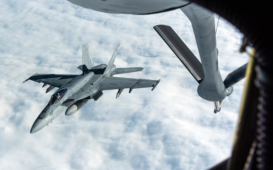 A Navy F/A-18E Super Hornet assigned to Carrier Air Wing 5 at Marine Corps Air Station Iwakuni, Japan, disconnects from a KC-135 Stratotanker while training on Jan. 10, 2020.