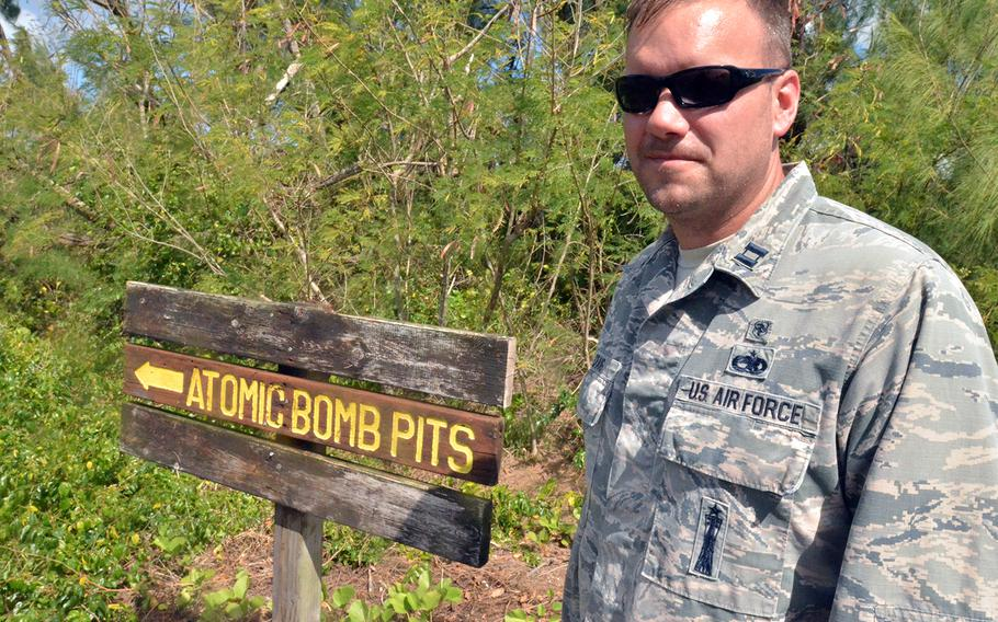 Air Force Capt. Joshua Craig, 36, a medical officer who maintained nuclear-capable cruise missiles earlier in his career, stands near the atomic bomb pits on the island of Tinian, Tuesday, Feb. 18, 2020. The site is where Fat Man and Little Boy were loaded onto the B-29 bombers that attacked Hiroshima and Nagasaki during World War II.