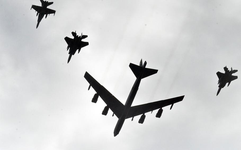 A B-52 Stratofortress bomber flies alongside fighter jets over Andersen Air Force Base, Guam, during the multinational Cope North exercise, Wednesday, Feb. 19, 2020.
