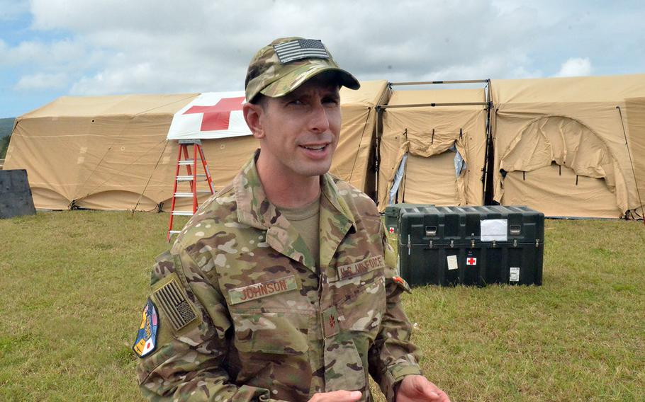 Air Force Maj. Brian Johnson, 35, a medical officer from Inman, S.C., speaks about leading a team of 40 troops who set up a four-bed field hospital during a Cope North drill on the island of Rota, Tuesday, Feb. 18, 2020.