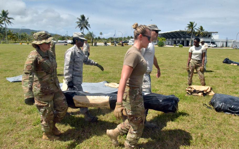Troops taking part in the multinational Cope North exercise work to set up a four-bed field hospital on the island of Rota, Tuesday, Feb. 18, 2020.
