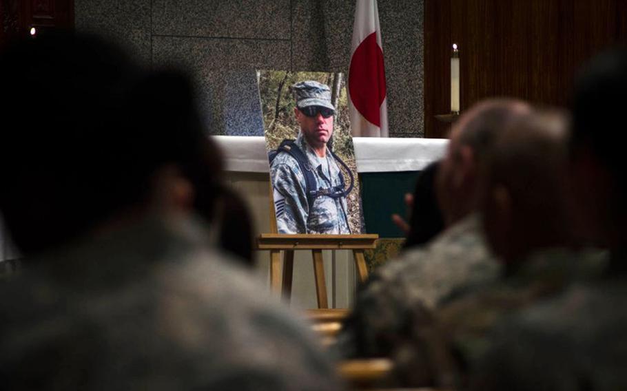 Service members attend a memorial ceremony for Master Sgt. Nicholas Vollweiler at Yokota Air Base, Japan, Nov. 16, 2018.