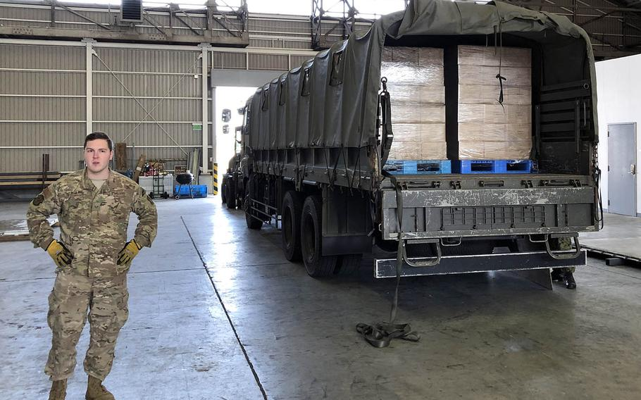 Air Force Staff Sgt. William McAtee stands by to unload a truck laden with Meals, Ready to Eat as part of Tomodachi Rescue Exercise at Yokota Air Base, Japan, Friday, Feb. 21, 2020.