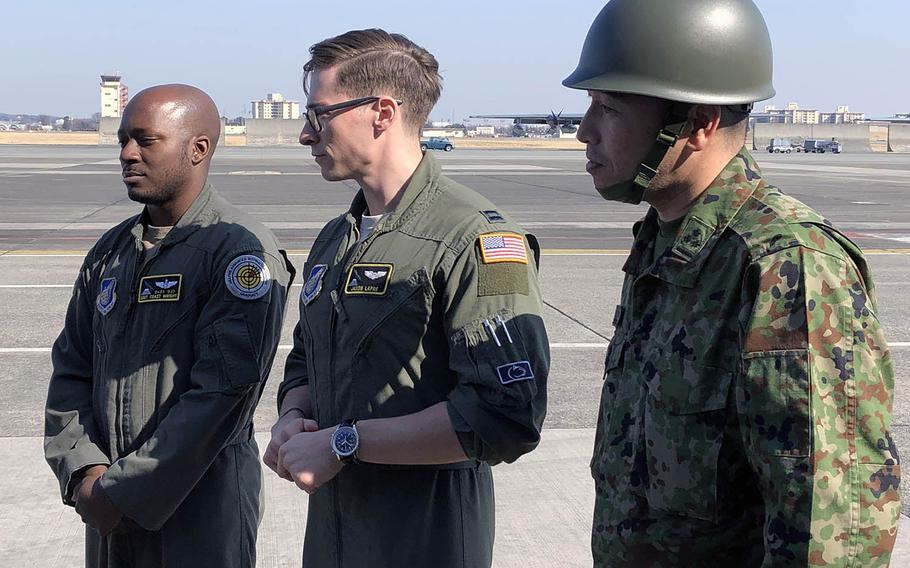 From left: Staff Sgt. Marcus Wright and Capt. Jason Le Pre of the U.S. Air Force join Capt. Hideyuki Hotsuki of the Japan Ground Self-Defense Force to speak with Japanese TV reporters during the Tomodachi Rescue Exercise at Yokota Air Base, Japan, Friday, Feb. 21, 2020.