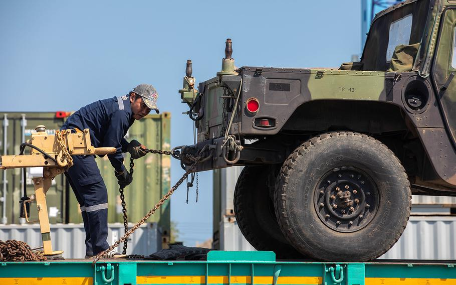U.S. military vehicles are off-loaded in Chuk Samet, Thailand, Feb. 17, 2020, ahead of the multinational Cobra Gold exercise.