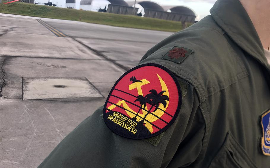 """The 18th Aggressor Squadron out of Eielson Air Force Base, Alaska, is wearing Soviet-inspired """"hardship tour"""" patches during Cope North drills this month at Andersen Air Force Base, Guam."""