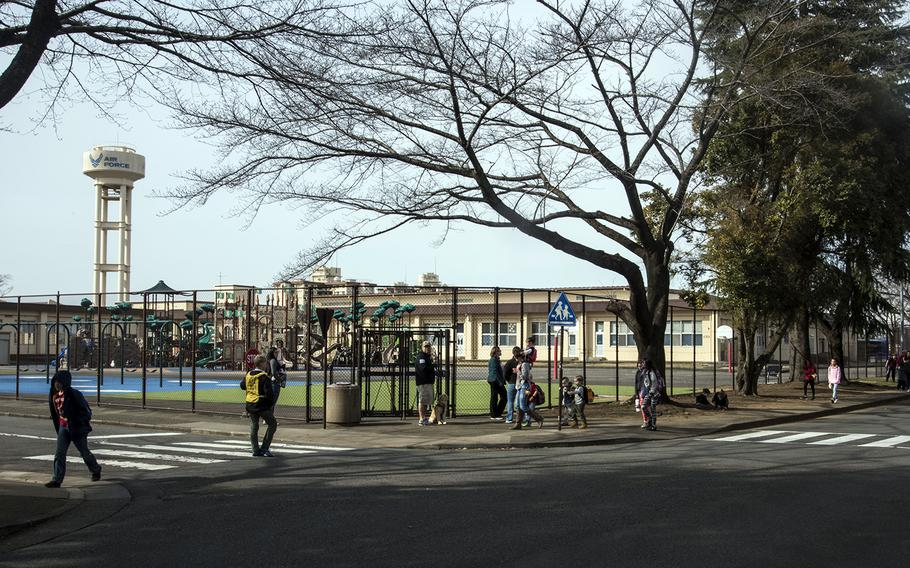 Students from Joan K. Mendel Elementary School at Yokota Air Base, Japan, walk home after classes on Friday, Feb. 28, 2020.