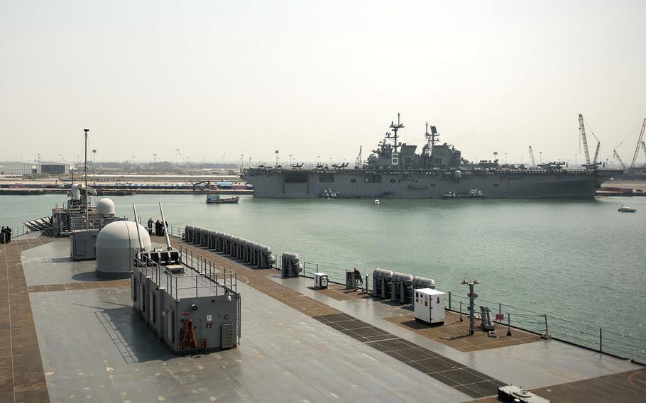 The amphibious assault ship USS America is seen from the 7th Fleet flagship USS Blue Ridge in Laem Chabang, Thailand, Feb. 23, 2020.
