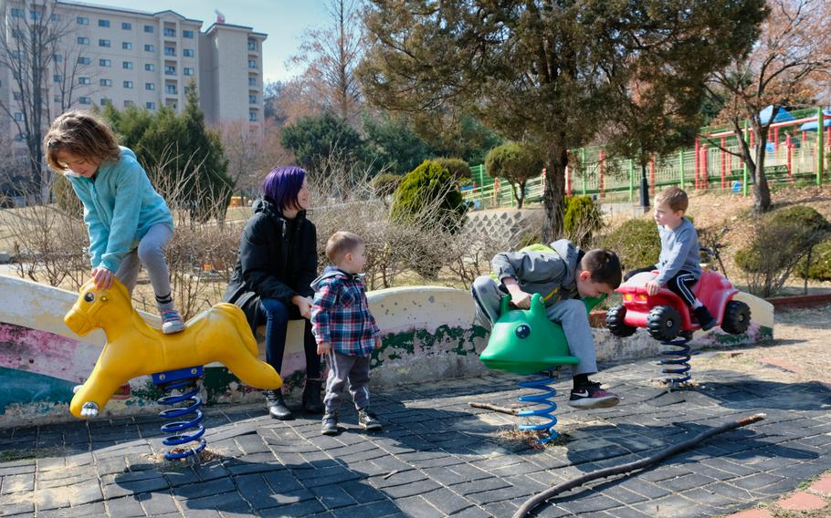 Cindy Badger, a military spouse, watches her four children at a playground on Osan Air Base, South Korea, Monday, March 2, 2020.
