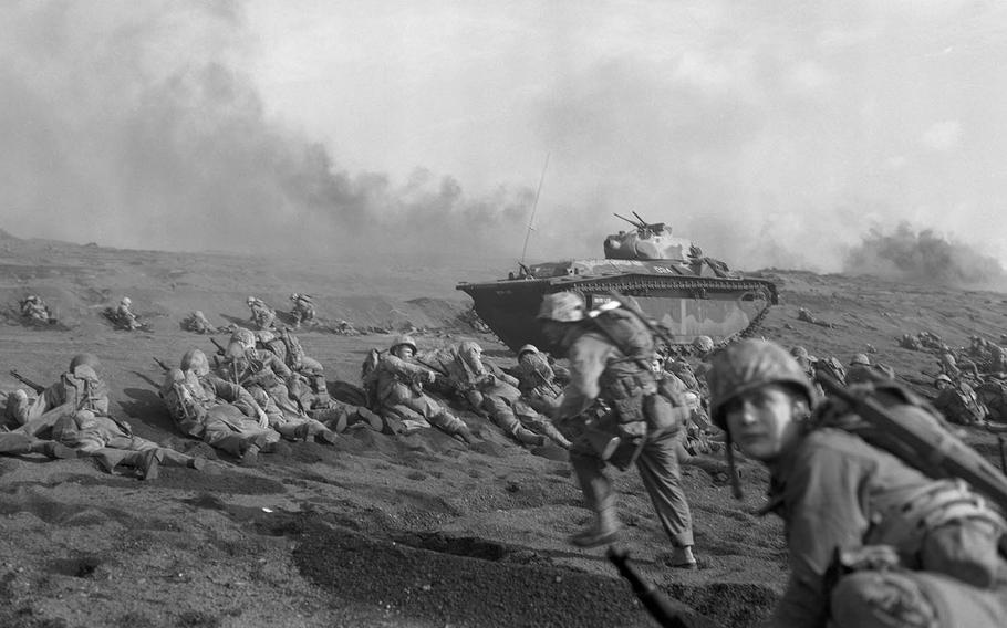 This undated photo from the National Archives depicts the Marine Corps' 27th Regiment, 2nd Battalion landing on Iwo Jima in 1945.